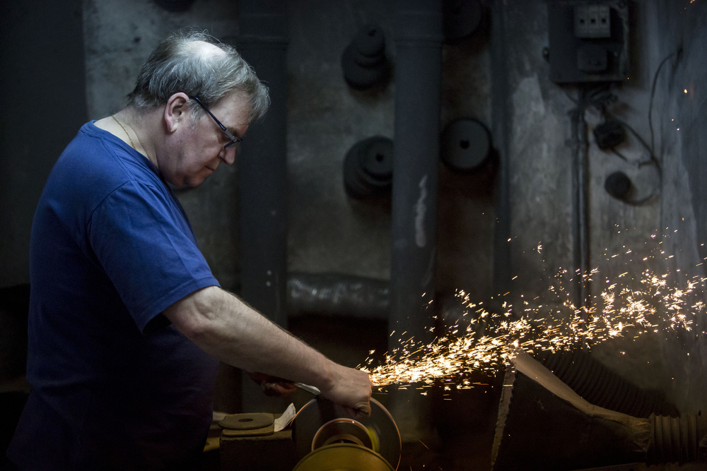 Mariano Zamorano, 63, polishes the blade of the sword in his workshop on June 5, 2015. Zamorano is one of the last artisan sword makers of Toledo, Spain.