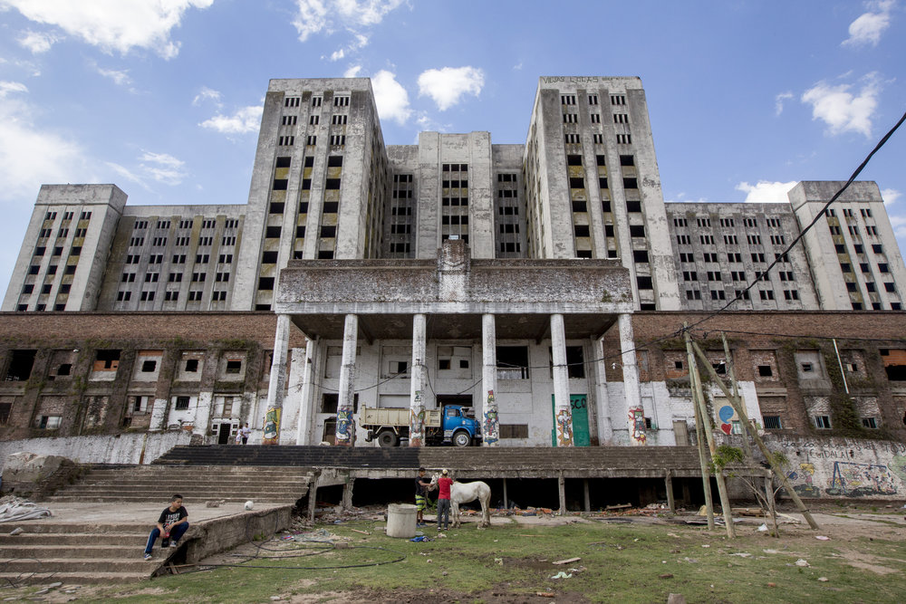The Elefante Blanco, or White Elephant, was a 14-story tall building meant to be the largest hospital in Latinamerica. The building started construction in the 1930s, but it stopped soon after due to lack of budget. It started up again during Peron's first two presidencies, but it was finally abandoned when he was ousted by a military coup in 1955. Since then, it has become part of the Villa 15, a shanty town also known as the Hidden City.