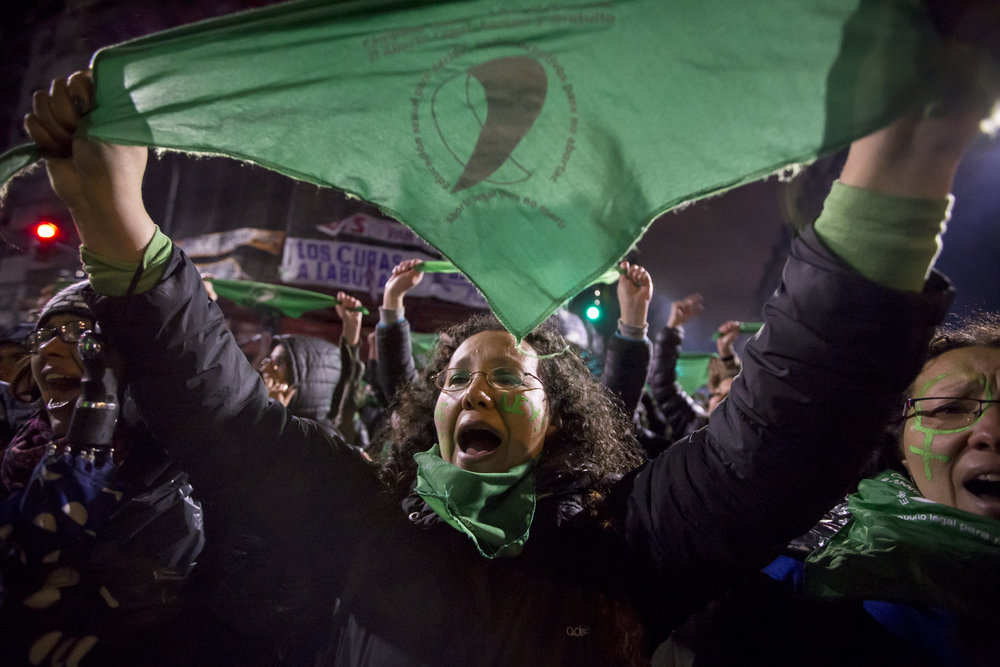 A woman protests with the green handkerchief –the symbol of the pro-choice movement – during the vigil of the bill which would de-criminalize and legalize abortion near the Senate in Buenos Aires, Argentina, on Aug. 8, 2018.