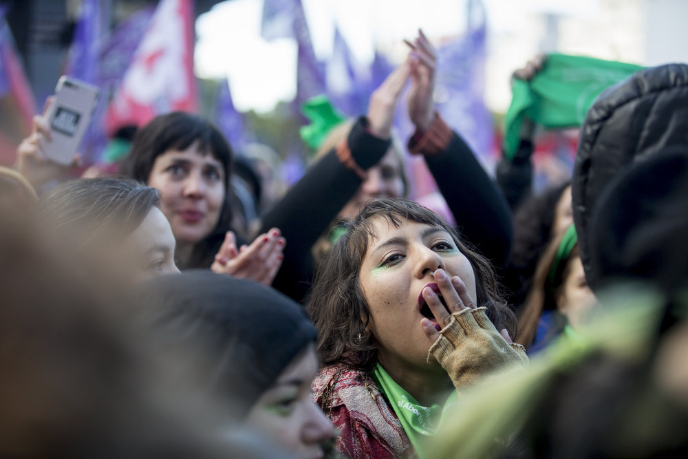 Women gather outside Congress during the debate in the lower house regarding the abortion bill in Buenos Aires, Argentina, on June 14, 2018.