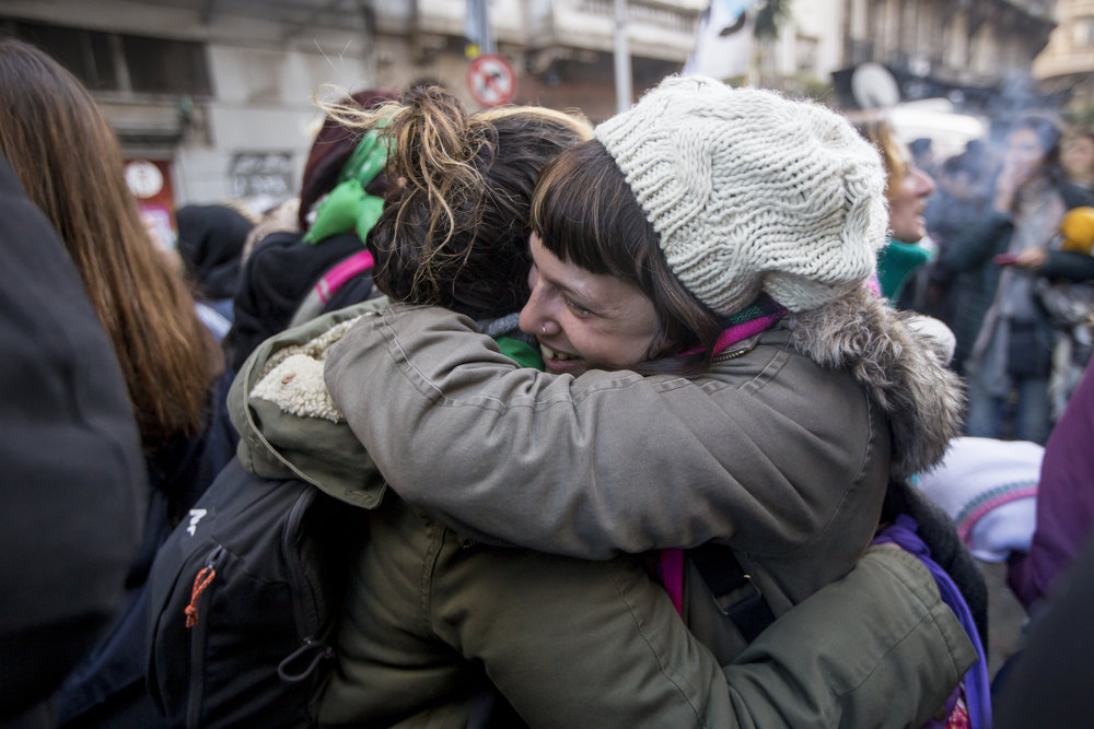 Women hug in the early hours of June 14th, 2018, after news that the bill had passed in the lower house, in Buenos Aires, Argentina. Hundreds of women stayed the night outside of the Congress as the debate neared almost 24 hours of duration.