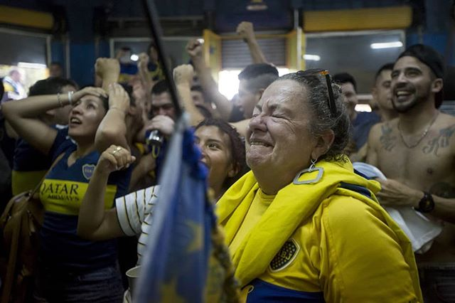 Cristina García Noris, 65, from La Boca, reacts after the second goal from Boca during the first leg of the final, in Boca Es Pueblo, a bar created and ran by fans. #onassignment for @espn #boca #buenosaires #argentina