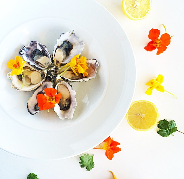 Oyster bloom with nasturtiums, lemon and coriander