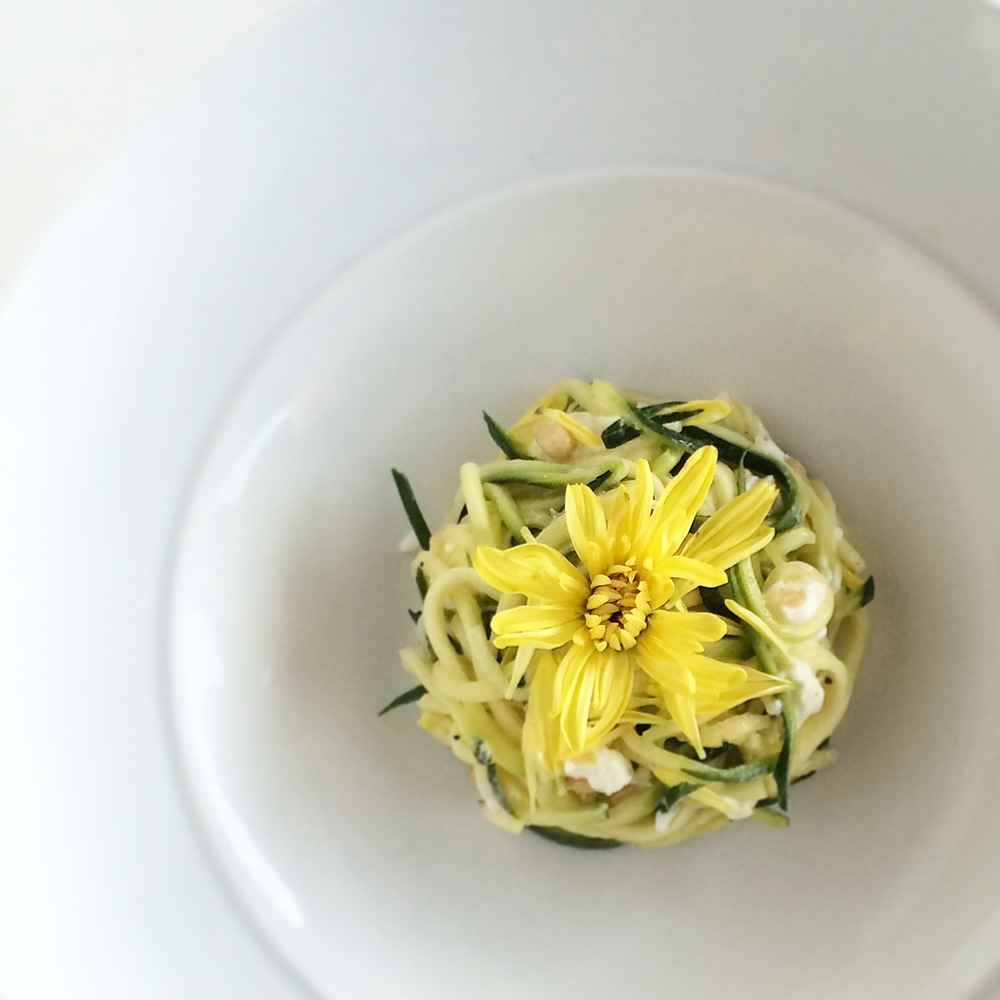 Zucchini noodles, goat cheese, pinenuts, chrysanthemum, gold flake mustard