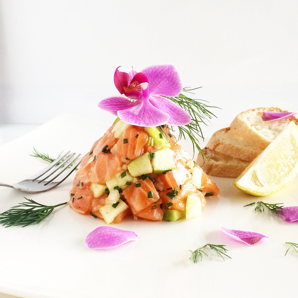 Salmon and green apple tartare with orchids