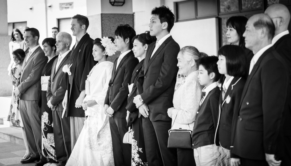 Alan & Ai with their families during their wedding in Futara San Shrine, in Nikko, Tochigi, Japan.
