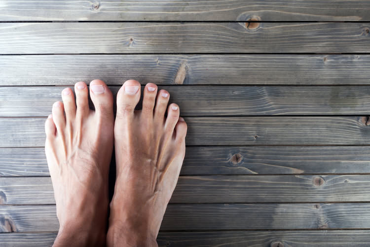 bare feet on a wooden surface.jpg