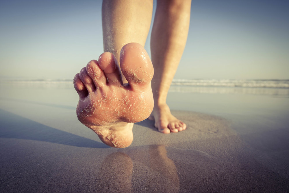 barefoot walking on the beach.jpg