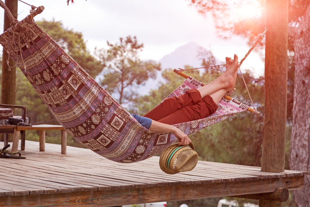 person in hammock relaxing barefoot.jpg