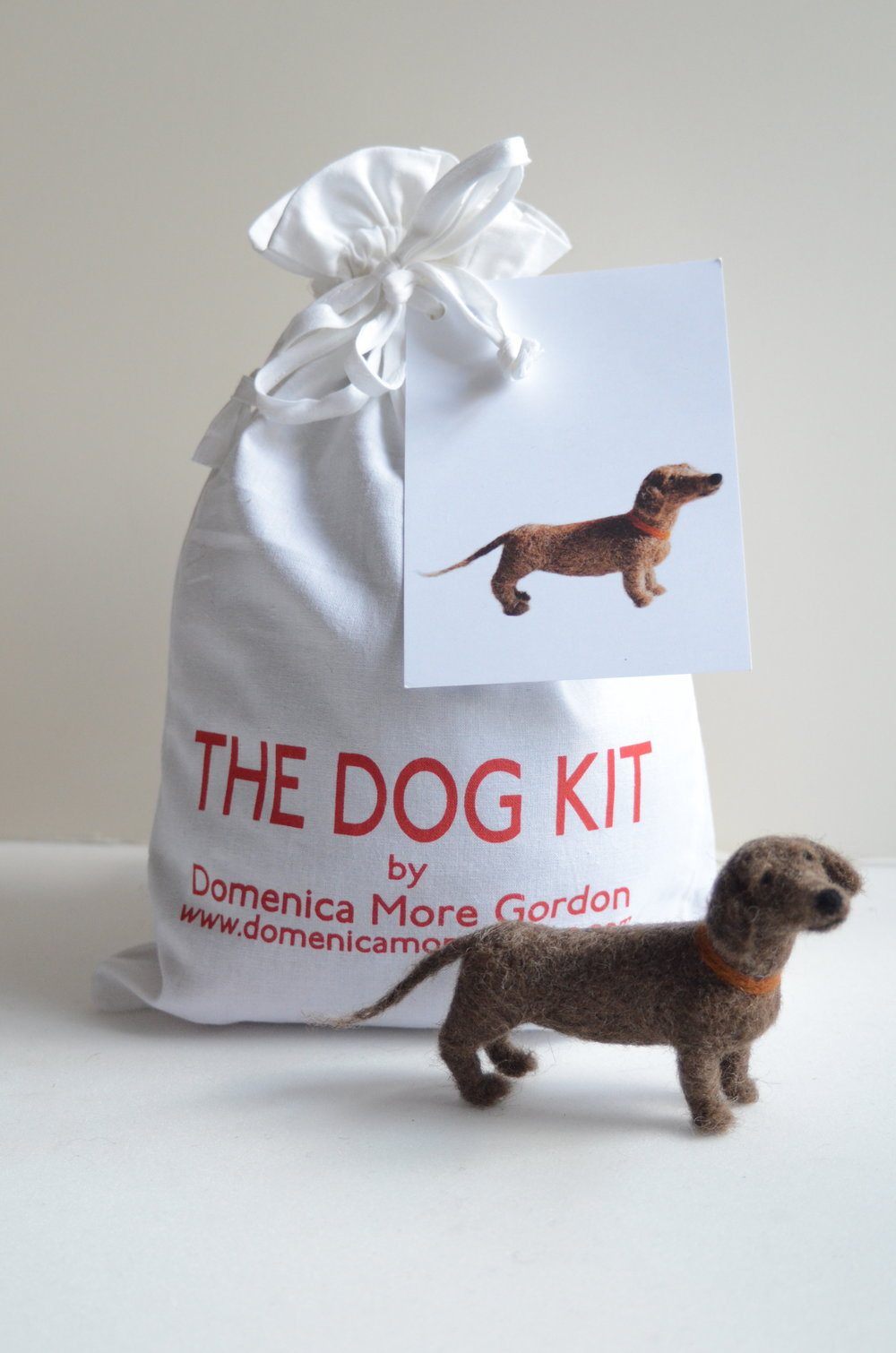 SAUSAGE DOG KIT Includes wool, needles and instructions. PLEASE CHOOSE YOUR REGION FROM THE DROP-DOWN MENU BELOW FOR PRICE INCLUDING POSTAGE AND PACKING