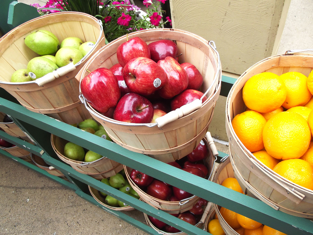 An assortment of fruit to choose from in bushels.