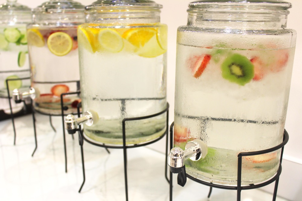 Many flavors of fresh fruit-infused water.