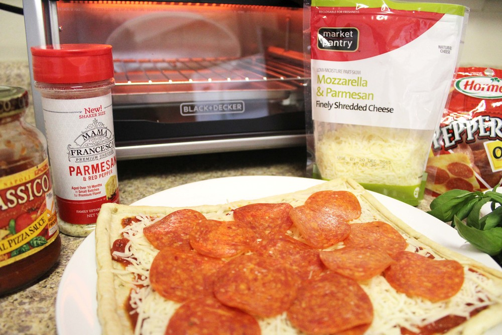 Add as much pepperoni as you want! I don't like to be limited on pepperoni, so I covered my entire pizza.