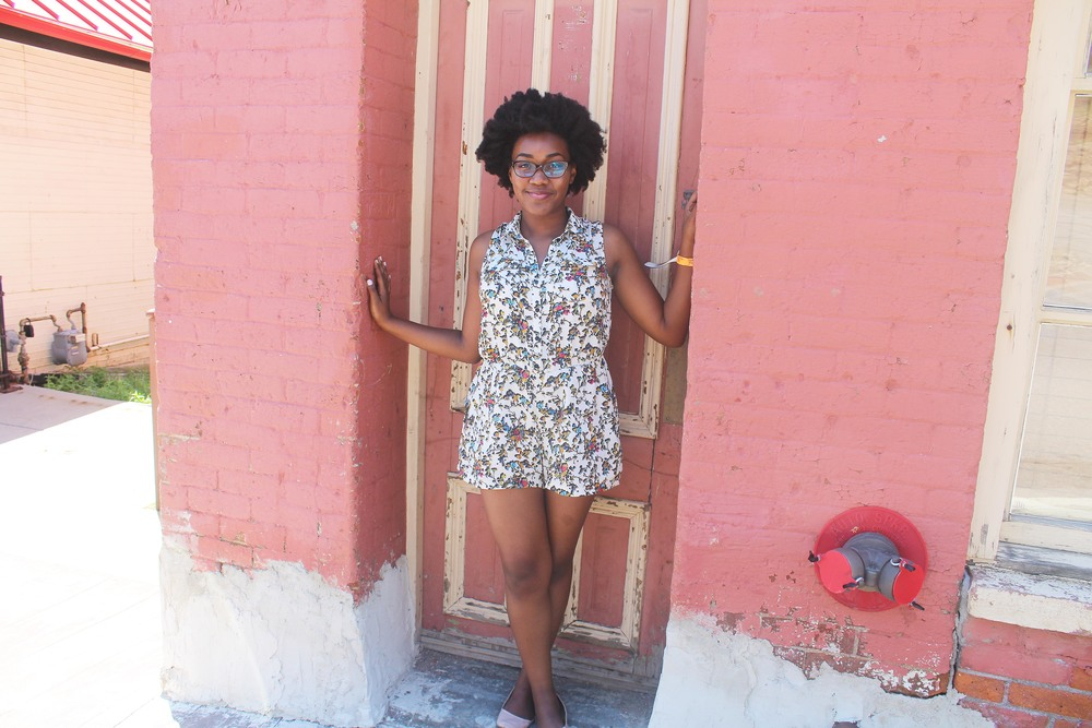 Me in front an empty building in Central City in Topshop romper.