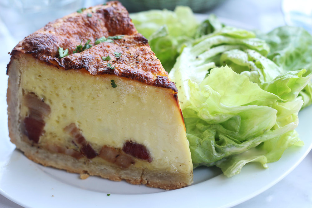 Quiche Lorraine served with salad at Mercat Bistro on Harwood in Dallas.