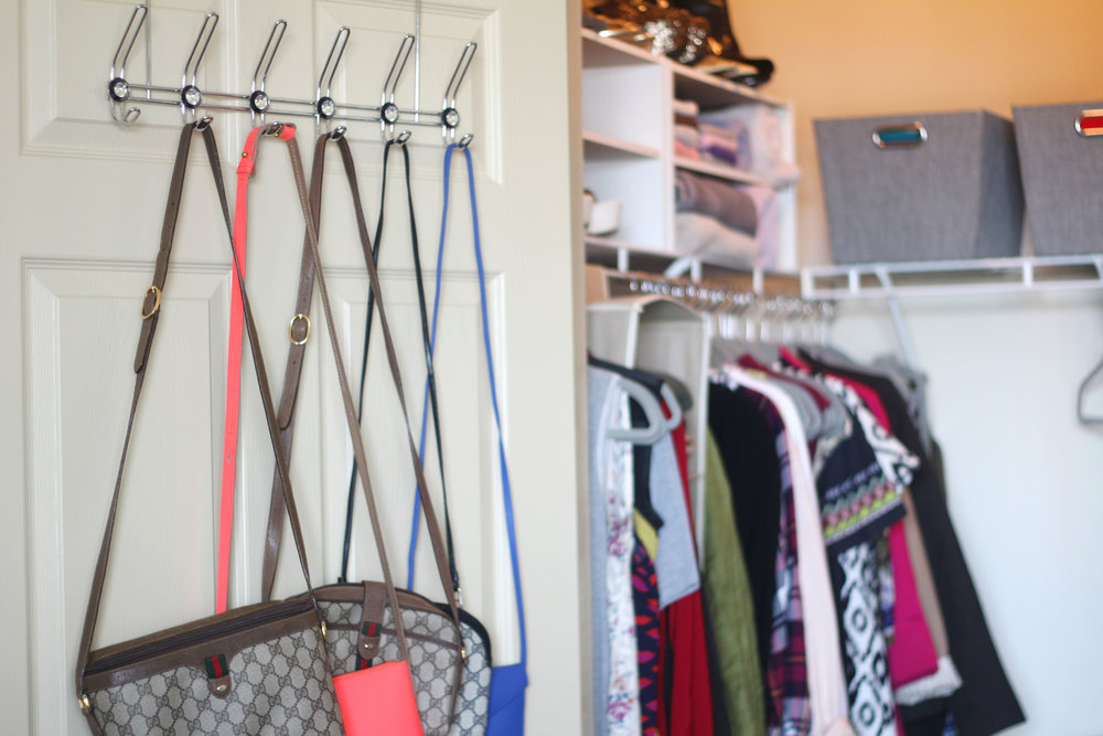 Purses on a glamorous chrome 6-hook over the door rack from At Home ($9.99)