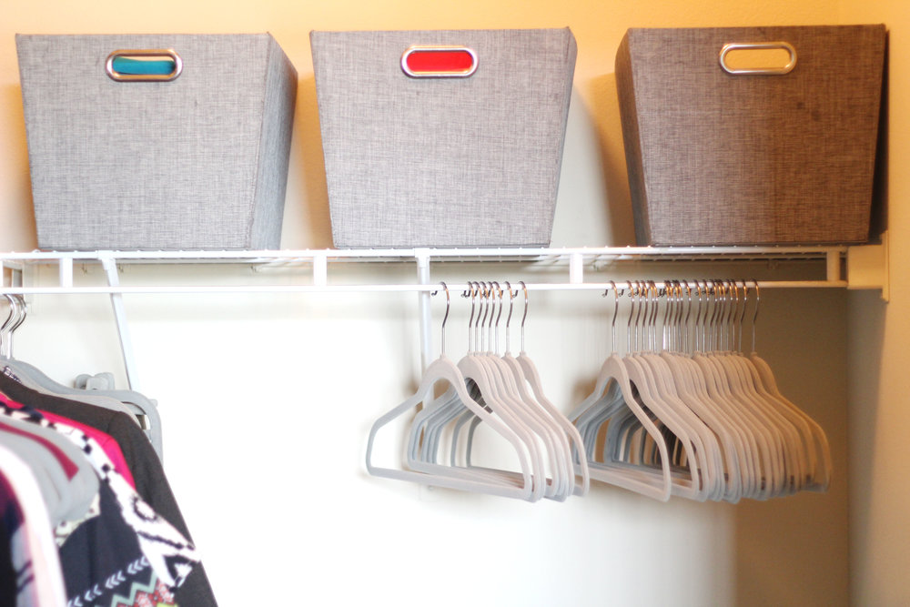 Three large shelf storage totes in grey ($12.99 each); Velvet hangers in light grey ($19.99 per 50-pack)