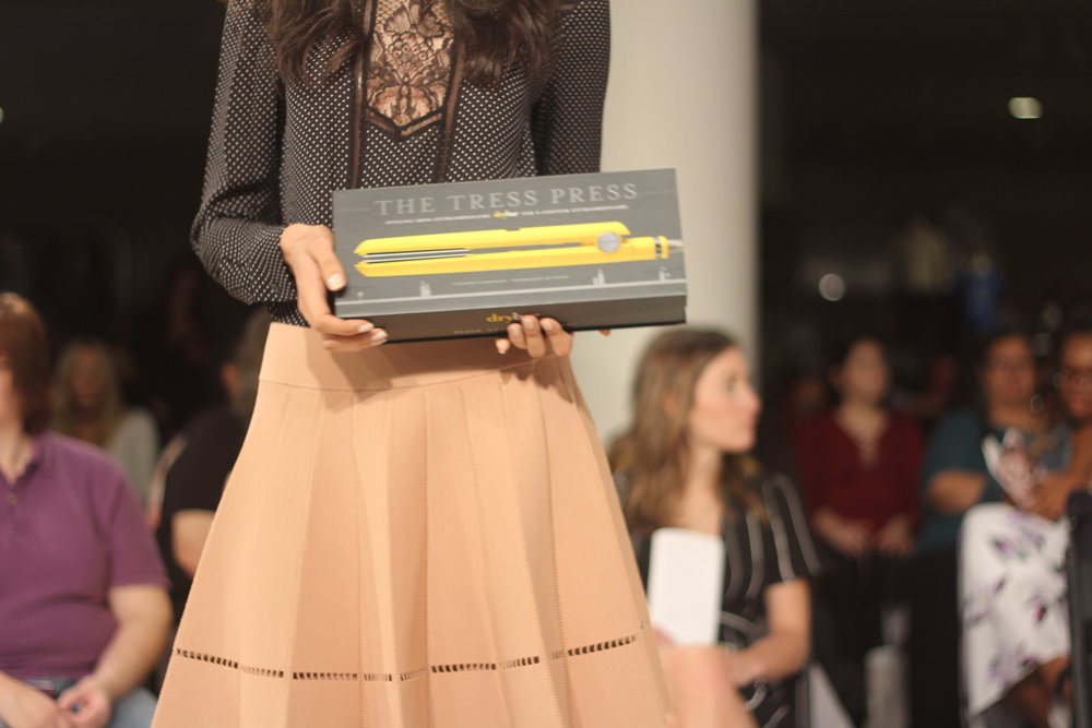 Nordstrom Beauty Trend Show model dressed in ALC while showing off the latest Drybar beauty gadgets.