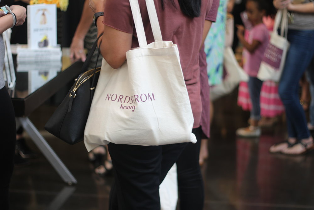 Customers join the fun in the mall for quick beauty makeovers and consultations with Drybar and Smashbox with their Nordstrom swag bags.
