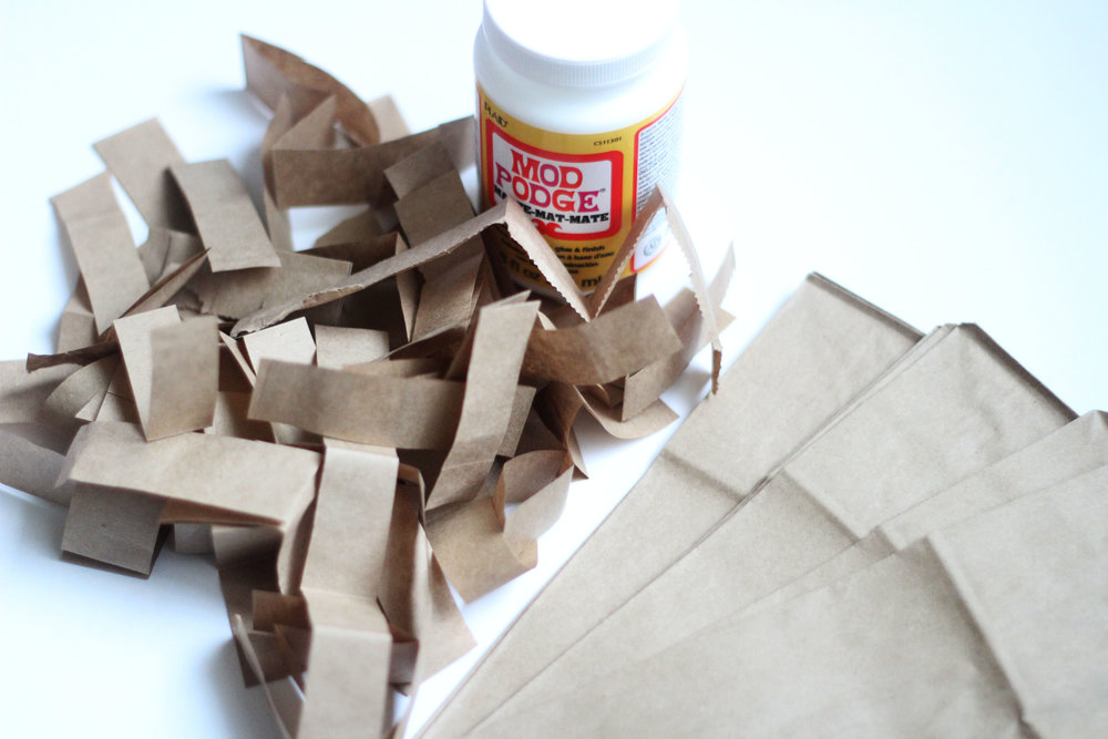 Cut brown paper sacks into several strips. These will create the paper mâché foundation with the Mod Podge.
