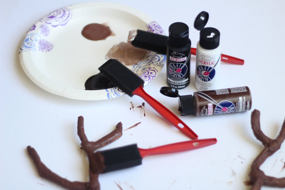 Wait for Mod Podge to completely dry overnight. In the morning, paint the antlers with the brown acrylic paint. Mix with black to create a deep brown and white for light brown. Continue painting with soft, strategic strokes for a more realistic look.