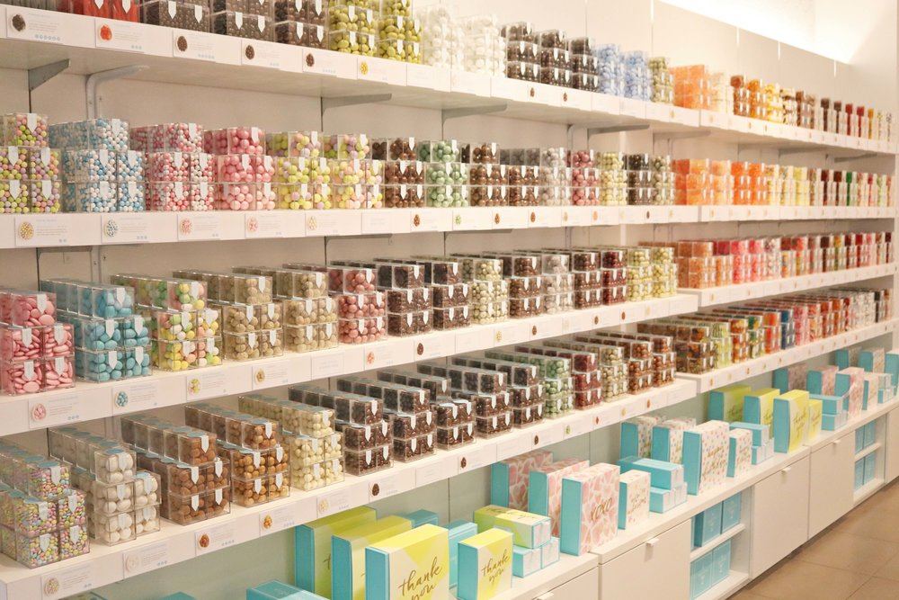 The wall of acrylic boxed luxury candies can be a little overwhelming for the first time, but there's a candy for everyone!