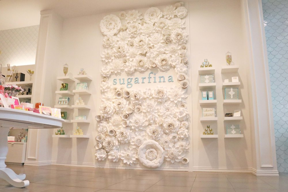 Beautiful Sugarfina floral mural makes the perfect Instagram photo!