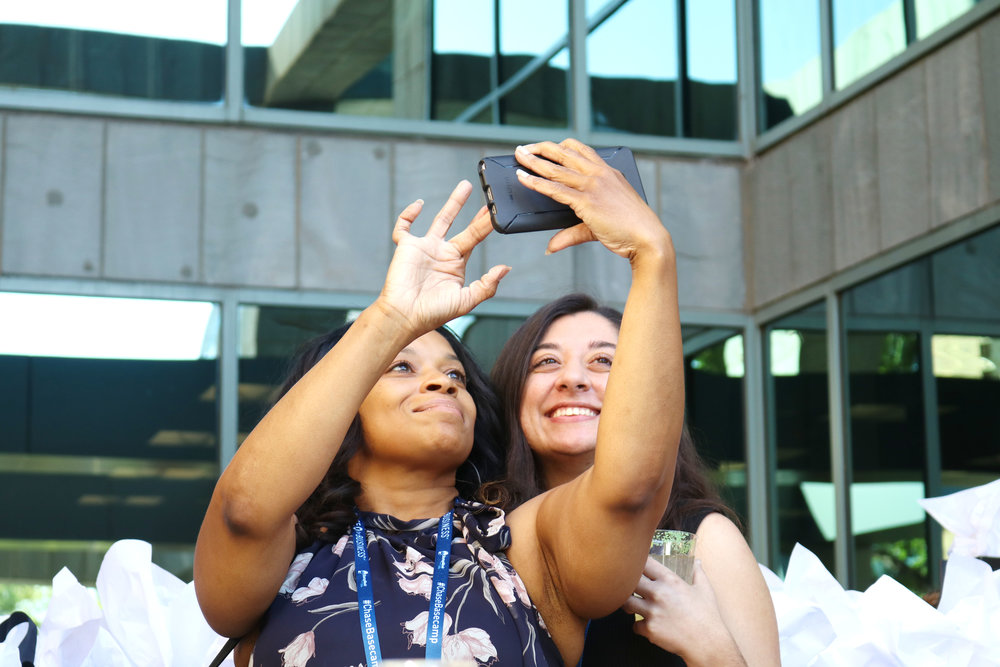 Many selfies were taken and memories created. Two attendees posing for a photo together on the terrace.