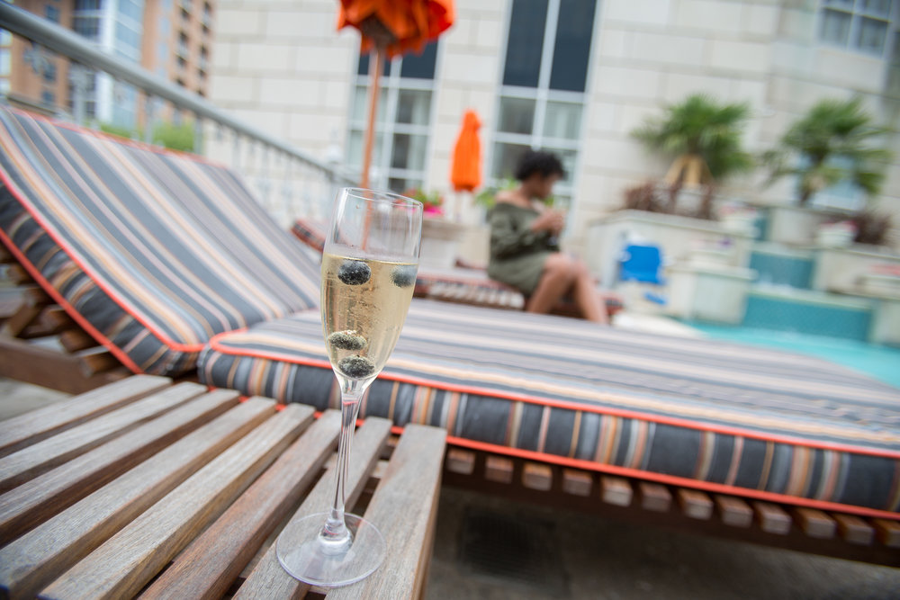 Champagne flute with Veuve Cliquot and fresh blueberries while I take photos on the cabanas for my Instagram. See the  final edit .