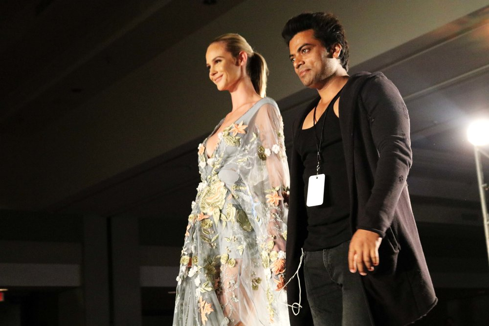 Meghan Edmonds and Sha Ali walking the runway during the final walk