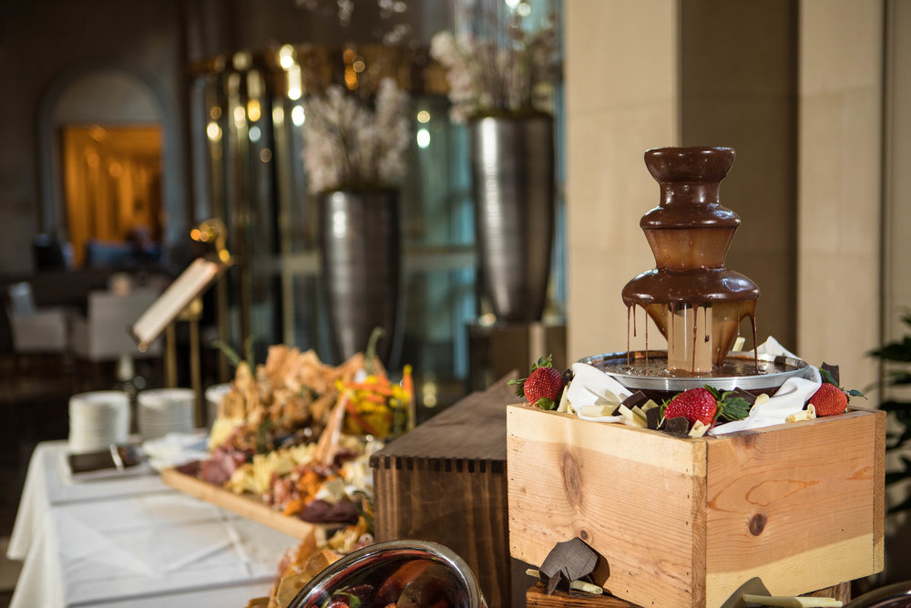 Chocolate fountain at the charcuterie table. Who doesn't love chocolate drizzled marshmallows and fresh strawberries?