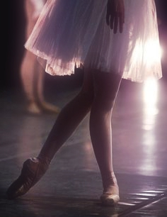 A ballet dancer standing in B Plus