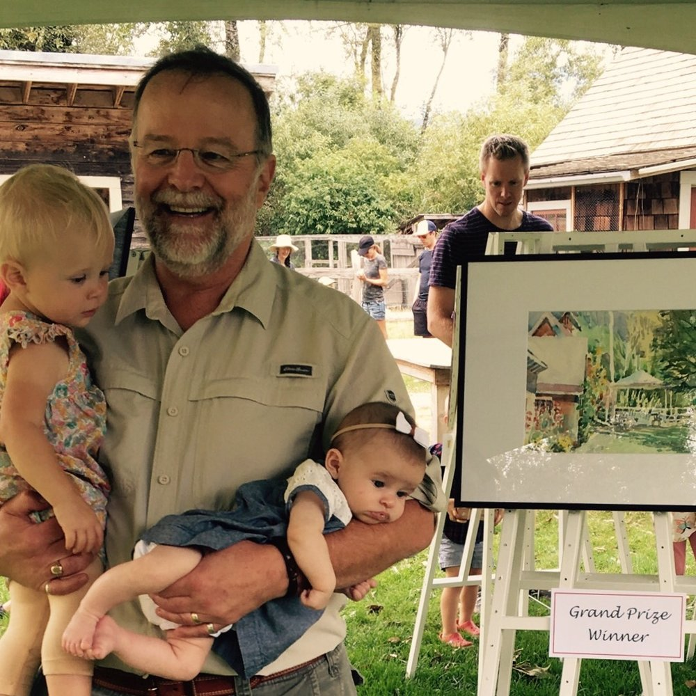 Wayne with his youngest granddaughters and prize-winning painting