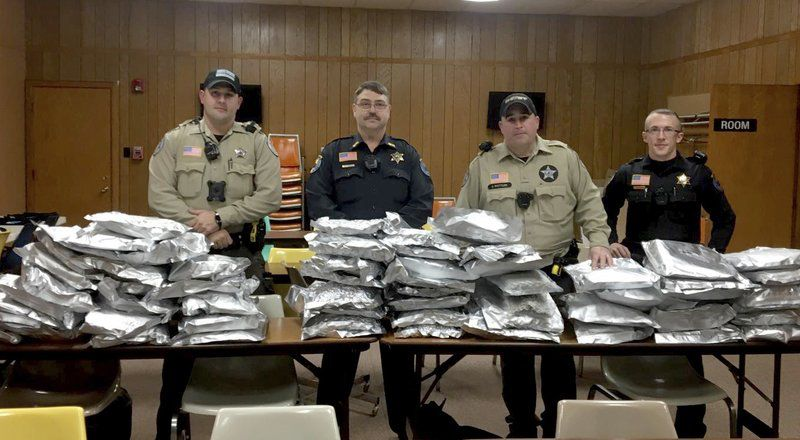 Pictured: Game masters taking several kilos of dangerous cell phones off the streets.