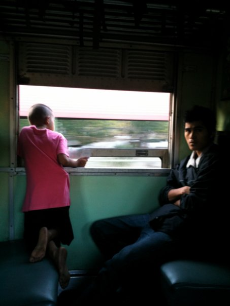 En route to Siem Reap, Cambodia from Bangkok, Thailand   You know you're on the right train when people stare at you and school kids wearing uniforms are hanging onto the train outside before they hop off.