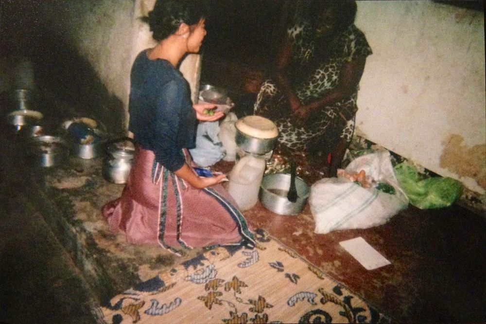 Kyebando, Kampala, Uganda Photo Credit: Pius Kadapao Kodak Disposable Camera   Mama Pius prepares dinner, but  first— she tests me of my knowledge of Ugandan produce by putting a few of them in my hand.