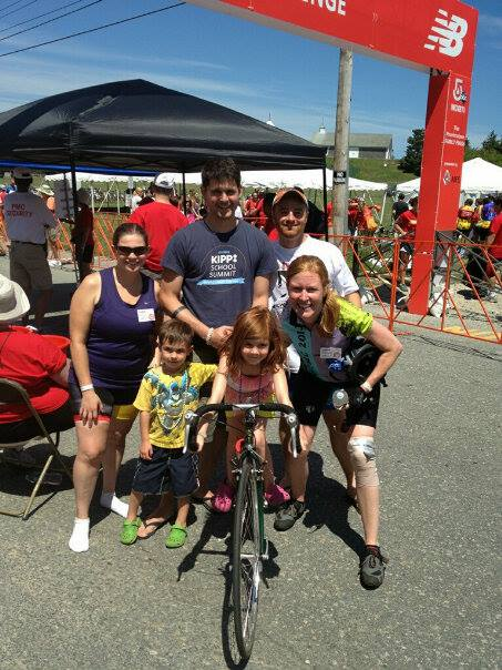 Susan with Laura and Laura's family at the 2014 PMC finish line