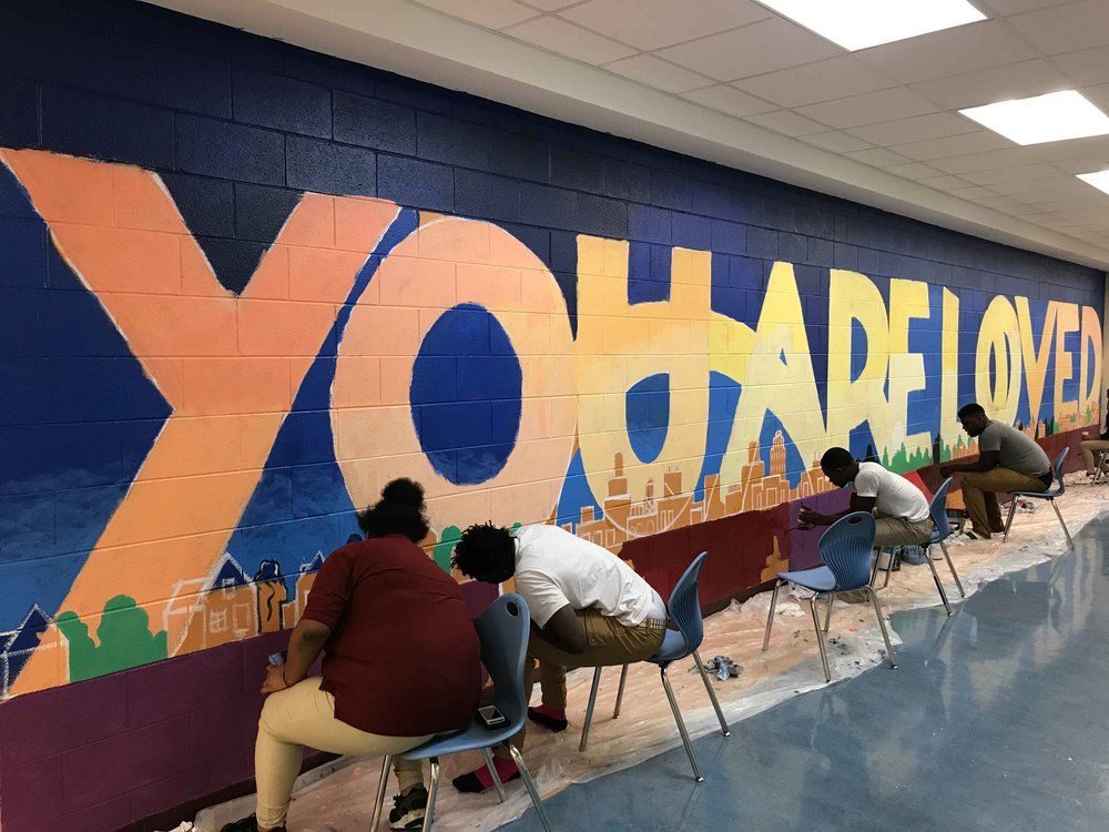 Students paint the above mural at Mumford High School, in Detroit, MI.
