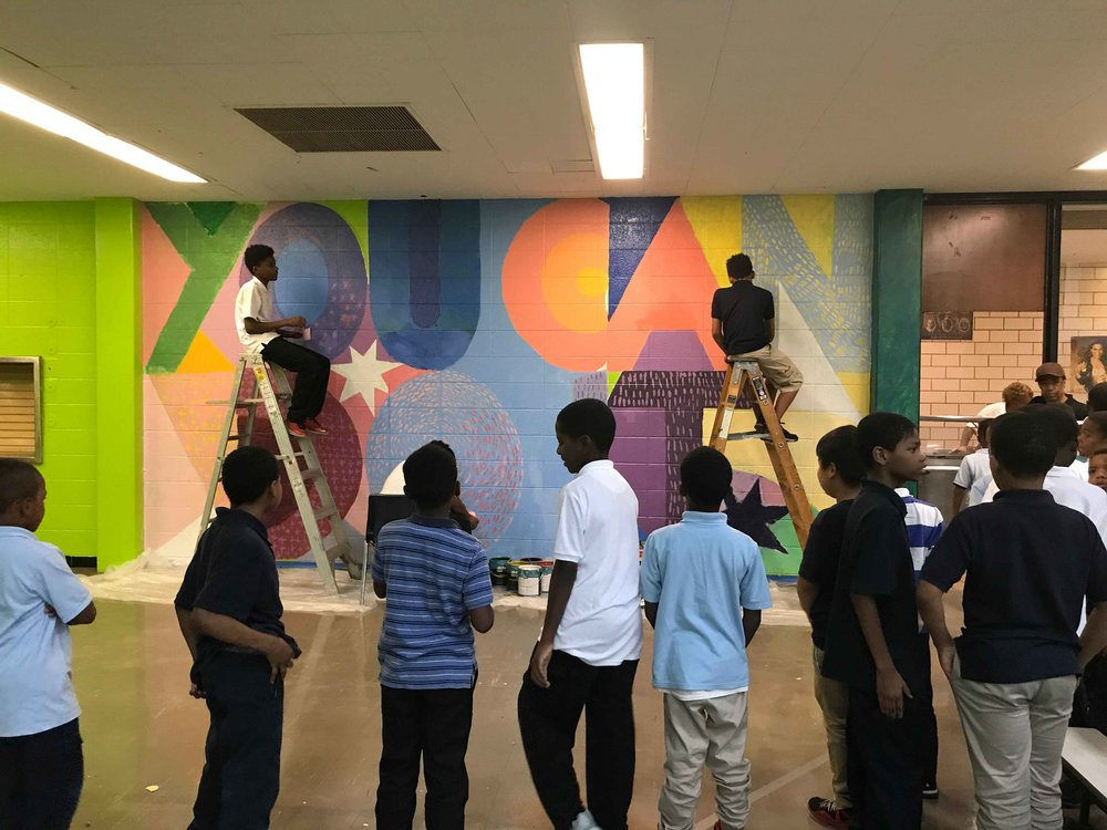 Kids in line for lunch watch while others work on the mural. Sampson Webber Academy, Detroit, MI.