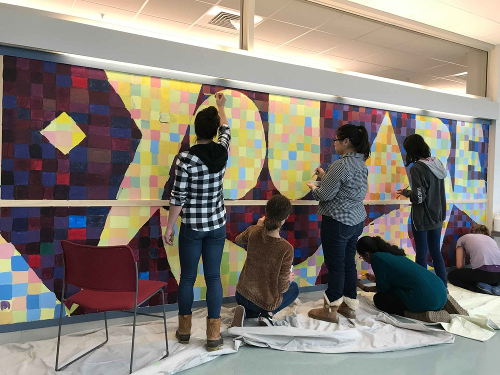 Students at Lincoln-Sudbury (MA) High School fill in thousands of colored squares in this YOU ARE IMPORTANT mural.