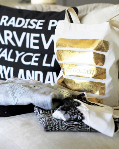 An example of a monthly shipment of Golden tote curated clothing totes.
