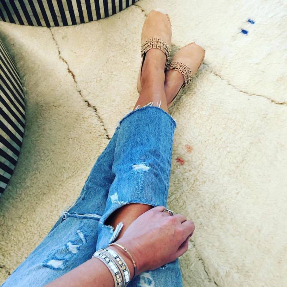 Raw hemmed jeans are new to the scene. Pair them with espadrilles or heels. Accessorized with the Cady Wrap and Resilience Cuff from Stella & Dot.