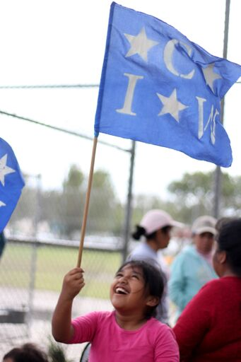 CIW flag child laughing.jpeg