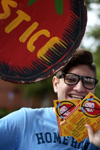 student smiling with flyers.jpeg