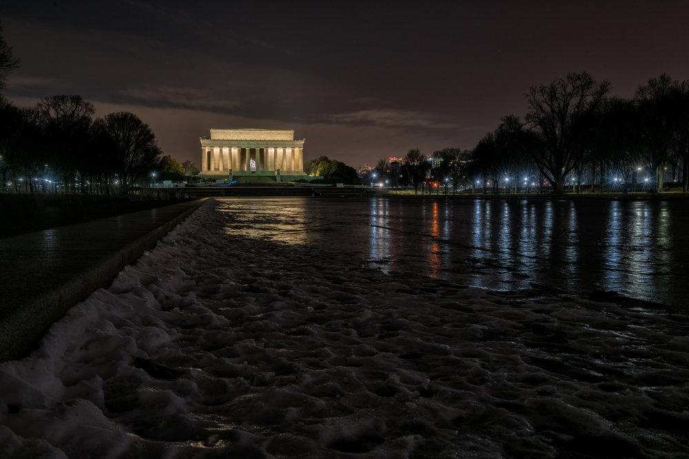 One of the unique situations early this year is the frozen reflecting pool in front of the Lincoln Memorial and I love these early morning shots with the glow of the city lights across the ice.