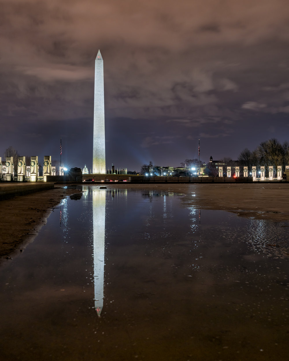 This was a bit of a unique angle as I was able to step out into the reflecting pool as the water is starting to thaw and some fun textured water for reflections of the flags, State Capitol, World War II Memorial and Washington Monument.