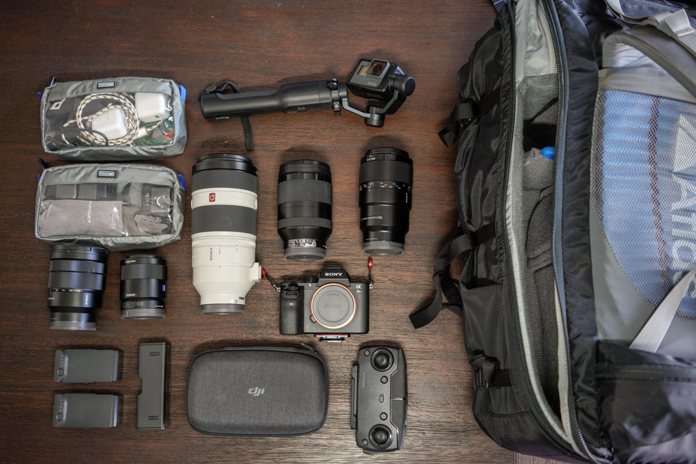 Same gear as above but on the table.  With the addition of the Sony 16-35 (usually on the Sony A7R III), the Sony 55mm 1.8 and the 35mm 2.8 (taking this picture).  I usually have the 35/55 in the top compartment in separate protective bags when fully loaded (for now)