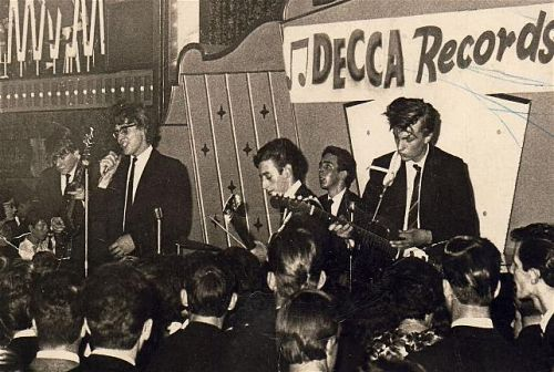"Eddlie Levine and the Escorts at the Mecca Ballroom in Grimsby 1963 - L to R: bassist Mars Cowling, singer Eddie Levine, lead guitarist ""Memphis,"" drummer Geoff Knight, and ""Migs"" on second lead guitar."