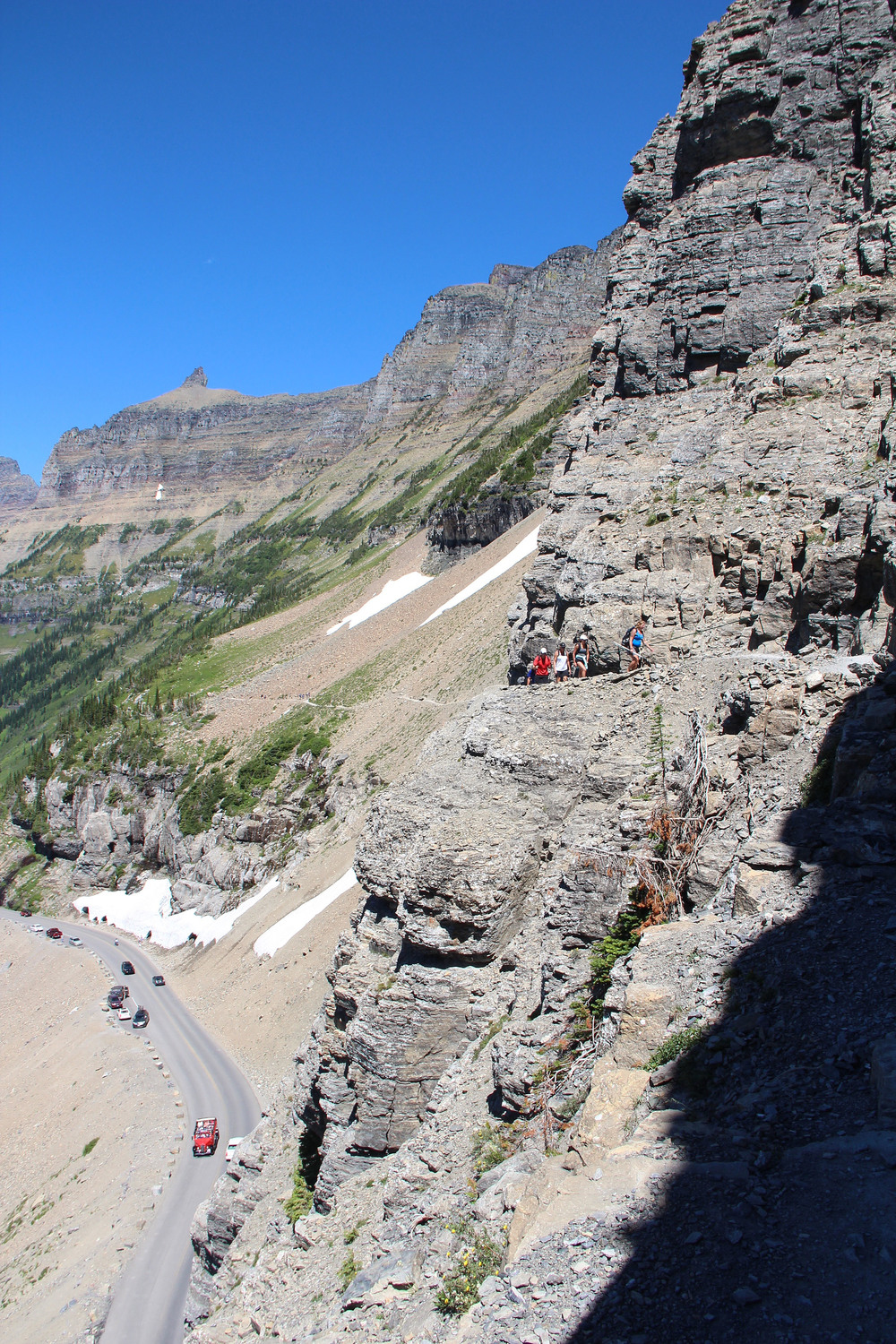 The Highline trail near its trailhead, with the Going to the Sun Road below.