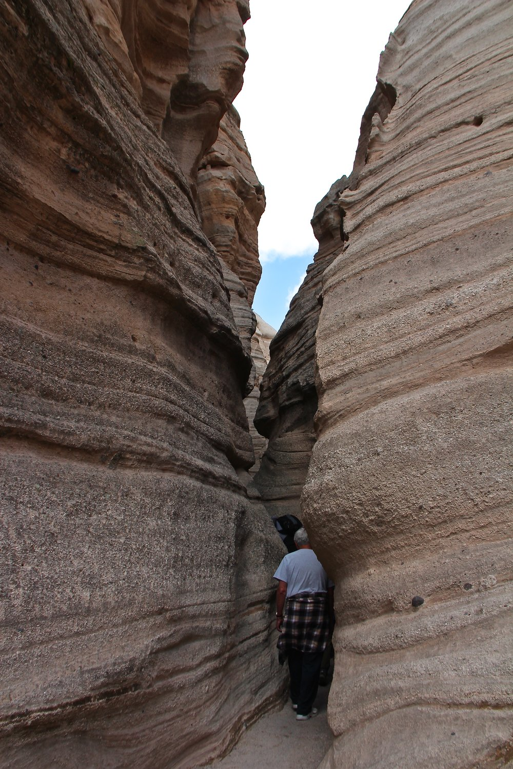 My dad snaking through the slot canyon at Tent Rocks.